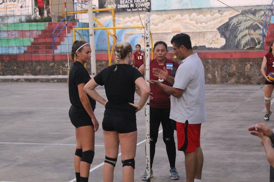 Volleyball team with children