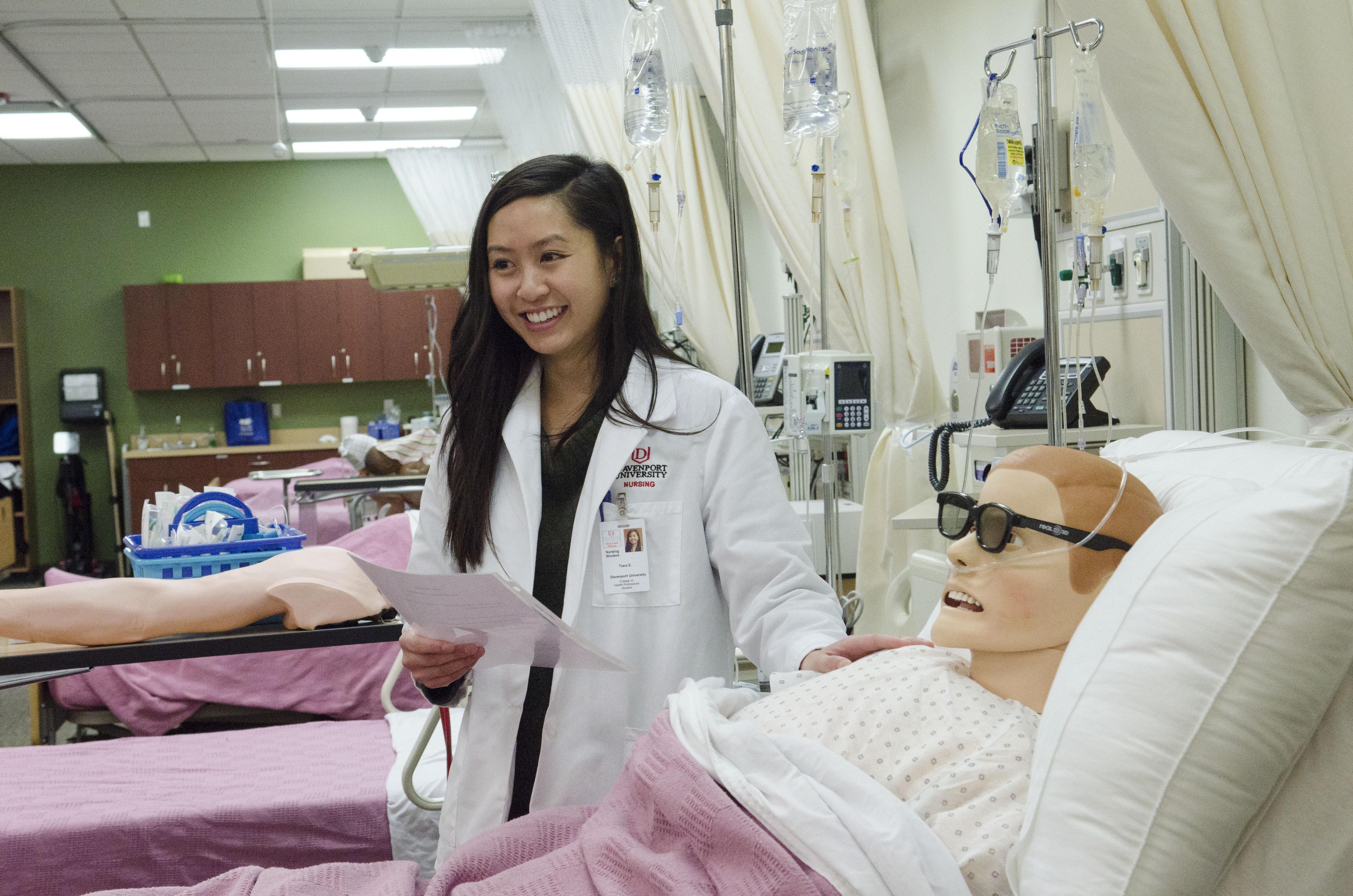 Tiara Escondo, a nursing student, with a simulator